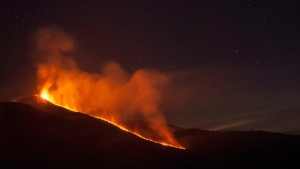 In this picture provided Monday, Dec. 7, 2015, lava flows down Mt. Etna volcano during an eruption, near Catania, Italy, late Sunday, Dec. 7, 2015. (AP / Salvatore Allegra)