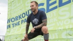 "Bob Harper, trainer on ""The Biggest Loser,"" leads thousands of attendees in a body-blasting workout at SELF magazine's 21st annual Workout in the Park in Chicago's Grant Park, Saturday, May 17, 2014. (Photo by Peter Barreras /Invision for SELF/AP Images)"