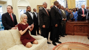 Counselor to the President Kellyanne Conway kneels on a couch, left, as U.S. President Donald Trump meets with leaders of Historically Black Colleges and Universities (HBCU) in the Oval Office of the White House on Feb. 27, 2017. (Pablo Martinez Monsivais / AP)
