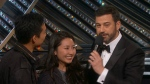 Patrick, left, and Yeulree Tio talk to Jimmy Kimmel at the Academy Awards on Sunday, Feb. 26, 2017. (CTV News)