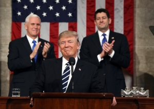 U.S. President Donald Trump, flanked by Vice President Mike Pence and House Speaker Paul Ryan of Wis., arrives on Capitol Hill in Washington, Tuesday, Feb. 28, 2017, for his address to a joint session of Congress. (Jim Lo Scalzo / Pool Image via AP)