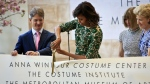 In this May 5, 2014 file photo, Vogue editor Anna Wintour, second from right, Metropolitan Museum director Thomas Campbell, left, and museum president Emily Rafferty, right, looks on as first lady Michelle Obama cuts the ribbon at a dedication ceremony for the Anna Wintour Costume Center, at the Metropolitan Museum of Art in New York. (AP / Bebeto Matthews, File)