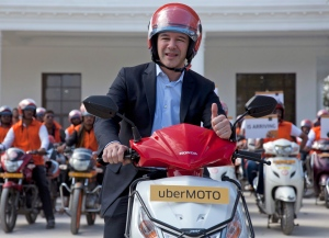 In this Dec. 13, 2016, file photo, Uber CEO Travis Kalanick, poses during the launch of its bike-sharing product, uberMOTO, in Hyderabad, India. (AP Photo/Mahesh Kumar A., File)
