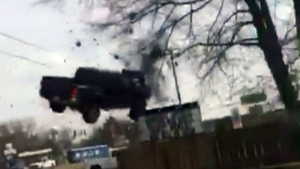 Truck goes airborne in wild police chase