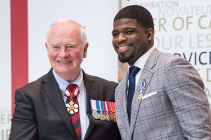 Nashville Predators' P.K. Subban poses with Governor General David Johnston after receiving the Meritorious Service Decoration in Montreal on Wednesday, March 1, 2017. (Paul Chiasson / THE CANADIAN PRESS)