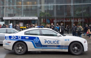 A police cruiser is shown outside Concordia University in Montreal, Wednesday, March 1, 2017, following a bomb threat. THE CANADIAN PRESS/Graham Hughes