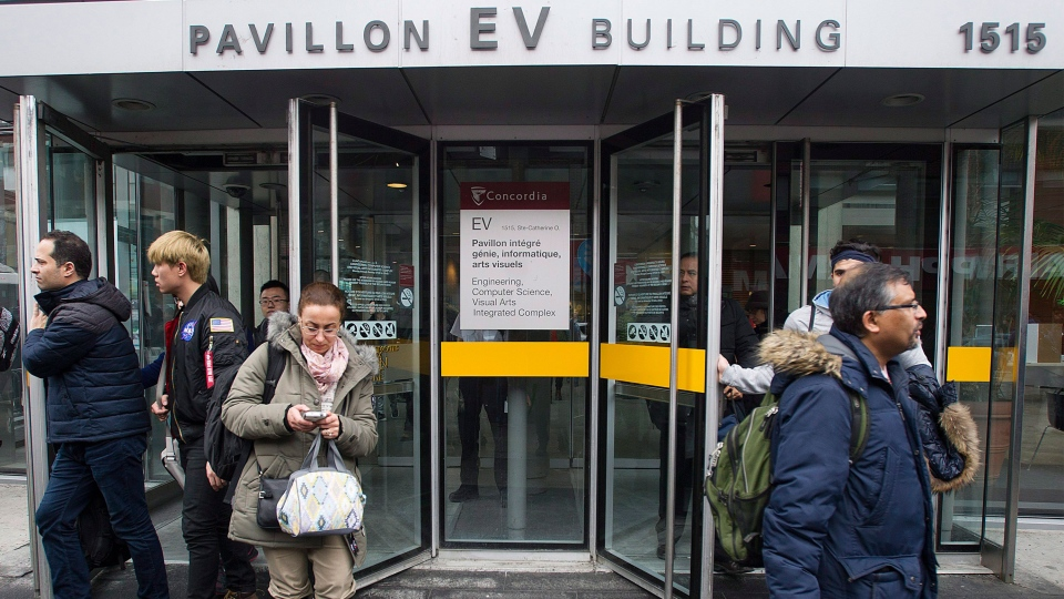 People are evacuated from Concordia University in Montreal, Wednesday, March 1, 2017, following a bomb threat. THE CANADIAN PRESS/Graham Hughes