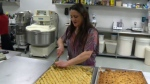 Samira Fayad, an immigration law program legal assistant, recently opened a bakery where a refugee can show off his baking skills