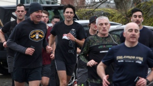 Prime Minister Justin Trudeau enjoys a morning run with members of the Canadian Forces at CFB Esquimalt in Esquimalt, B.C., on Thursday, March 2, 2017. (Chad Hipolito/The Canadian Press)