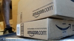 A United Parcel Service driver delivers packages from Amazon.com in Palo Alto, Calif. on June 30, 2011. (AP / Paul Sakuma)