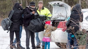 A group of refugee claimants from Eritrea arrive by taxi to cross the border from New York into Canada, Thursday, March 2, 2017 in Hemmingford, Quebec. (Ryan Remiorz / THE CANADIAN PRESS)