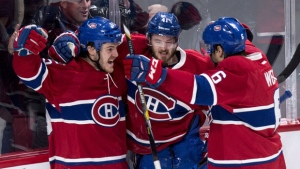 Montreal Canadiens' Paul Byron, centre, celebrates his goal against the Nashville Predators with teammates Andrew Shaw, left, and Shea Weber during third period NHL hockey action, in Montreal on Thursday, March 2, 2017. THE CANADIAN PRESS/Paul Chiasson