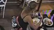 Camera catches restaurant patron putting her own hair in food