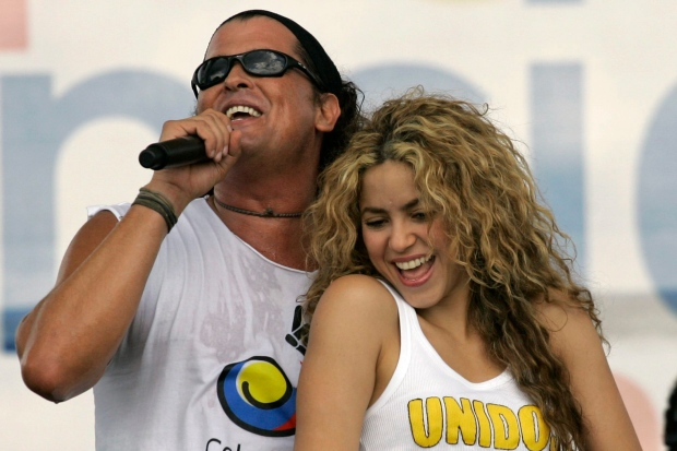 In this July 20, 2008 file photo, Colombian singers Shakira, right, and Carlos Vives perform during a 'concert for peace' Independence Day celebrations in Leticia, Colombia. (AP / William Fernando Martinez)
