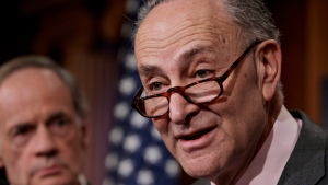 Senate Minority Leader Chuck Schumer of N.Y., left, accompanied by Sen. Tom Carper, D-Del., ranking member of the of the Senate Environment and Public Works Committee, speaks on Capitol Hill in Washington, Friday, Feb. 17, 2017. (AP / J. Scott Applewhite)