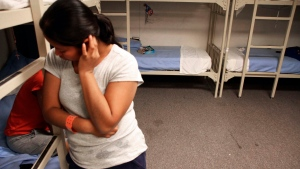 FILE - In this Sept. 10, 2014, file photo, an unidentified Guatemalan woman stands inside a dormitory in the Artesia Family Residential Center, a federal detention facility for undocumented immigrant mothers and children in Artesia, N.M. (AP Photo/Juan Carlos Llorca, File)