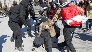 Anti-fascist protesters, left, clash with opposing protestors during a demonstration regarding motion M-103 in Montreal, Saturday, March 4, 2017. THE CANADIAN PRESS/Graham Hughes