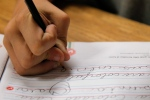 A student practices writing in cursive at St. Mark's Lutheran School in Hacienda Heights, Calif. on Thursday, Oct. 18, 2012. (AP / Jae C. Hong)