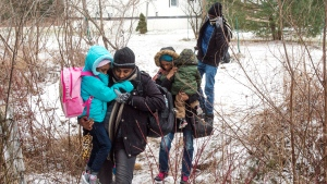 A group of refugee claimants, from Eritrea, cross the border from New York into Canada, Thursday, March 2, 2017 in Hemmingford, Que. THE CANADIAN PRESS/Ryan Remiorz