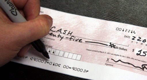 OPP are alerting residents to be aware of an overpayment scam that asks unsuspecting victims to reimburse partial payment of a counterfeit cheque. (Ryan Remiorz / THE CANADIAN PRESS)