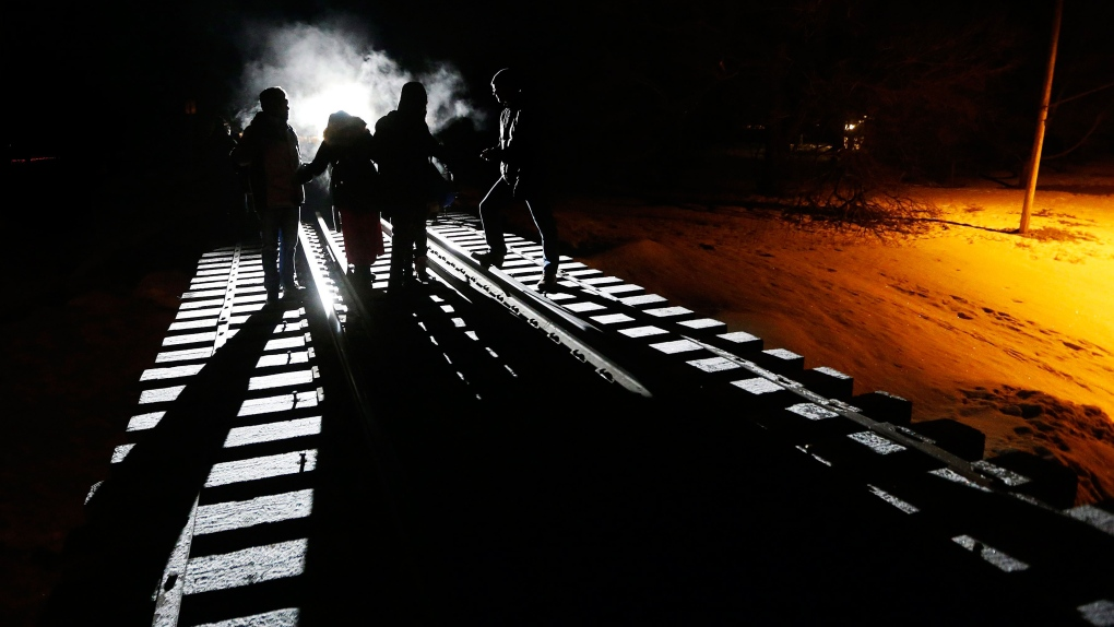 Migrants from Somalia cross into Canada from the U