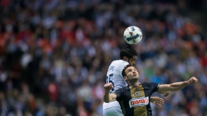 Philadelphia Union's Chris Pontius, front, and Vancouver Whitecaps' Sheanon Williams vie for the ball during the second half of an MLS soccer game in Vancouver, B.C., on Sunday, March 5, 2017. (Darryl Dyck / THE CANADIAN PRESS)