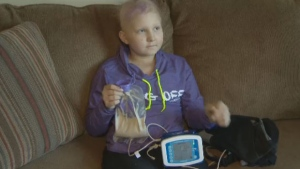 Karissa Bezanson, 11, has depended on a feeding machine for vital calories and vitamins since she was diagnosed with leukemia in November.