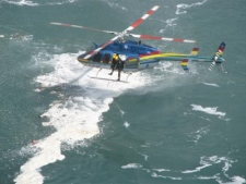 A helicopter hovers over the Niagara River after a man was swept over Horseshoe Falls on Wednesday, March 11, 2009. (Julia Nawrocki / MyNews.CTV.ca)