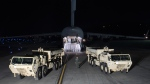 Trucks carrying parts of U.S. missile launchers and other equipment needed to set up Terminal High Altitude Area Defense (THAAD) missile defense system arrive at Osan air base in Pyeongtaek, South Korea, on March 6, 2017. (U.S. Force Korea via AP)