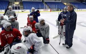 In this Dec. 15, 2016, file photo, Team USA women's hockey head coach Robb Stauber talks to his team during a practice session in Plymouth, Mich. (AP / Carlos Osorio)