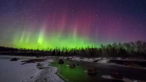 Northern lights over Rainbow Falls in Whiteshell. Photo by Lori Veenstra.