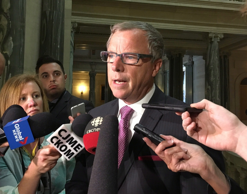 Saskatchewan Premier Brad Wall talks to members of the media in Regina, Tuesday, March 7, 2017. THE CANADIAN PRESS/Jennifer Graham