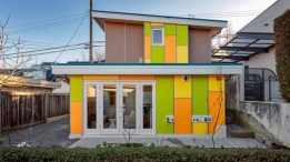 This colour-blocked Smallworks Studios laneway home in Vancouver's Kitsilano neighbourhood was inspired by the abstract paintings of Dutch artist Pieter Mondriaan. The colour doesn't end outside: inside the 650-square-foot custom home is energetic, custom bright blue marine millwork in the kitchen and a geometric tile mosaic backsplash in the bathroom. The tiny home, which features one bedroom, loft and a surprising amount of hidden storage, features numerous nods to the main house on the property, including recycled original hardwood on the upper level and reclaimed teak and wood used to make the living room hearth and shelves. (Photos by Ihor Pona)
