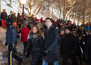 Prime Minister Justin Trudeau and his wife Sophie Gregoire Trudeau leave after visiting the Red Bull Crashed Ice World Championship at the Rideau Canal Locks, while Ottawa Mayor Jim Watson looks on, in Ottawa on Saturday, March 4, 2017. (Justin Tang / THE CANADIAN PRESS)