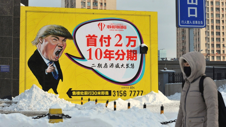 Real estate advertisement featuring a cartoon figure resembling U.S. President Donald Trump in Shenyang, Liaoning, China on Feb. 22, 2017. (Chinatopix via AP)