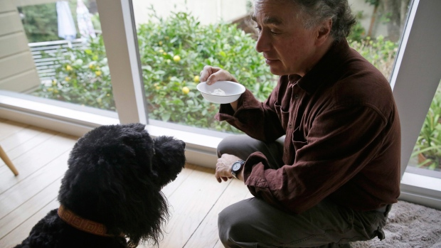 Michael Fasman feeds his dog cannabis tincture