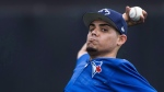 Toronto Blue Jays closer Roberto Osuna warms up during baseball spring training in Dunedin, Fla., on Wednesday, February 22, 2017. (Nathan Denette / THE CANADIAN PRESS)