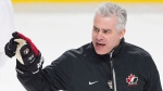 Team Canada head coach Dominique Ducharme gives instruction to players during practice ahead of their quarter-final round match against the Czech Republic at the IIHF World Junior hockey Championship in Montreal, January 1, 2017. (Graham Hughes/The Canadian Press)