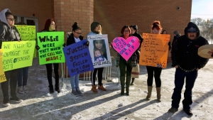 Family members of Nikosis Jace Cantre, a six-week-old boy killed in July 2016, hold posters outside Saskatoon Provincial Court on Wednesday, March 8, 2017. The family is calling for the teen girl who killed the baby to be sentenced as an adult. (Mark Villani/CTV Saskatoon)