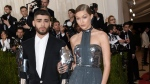 "Zayn Malik, left, and Gigi Hadid arrive at The Metropolitan Museum of Art Costume Institute Benefit Gala, celebrating the opening of ""Manus x Machina: Fashion in an Age of Technology"" on Monday, May 2, 2016, in New York. (Evan Agostini/Invision/AP)"