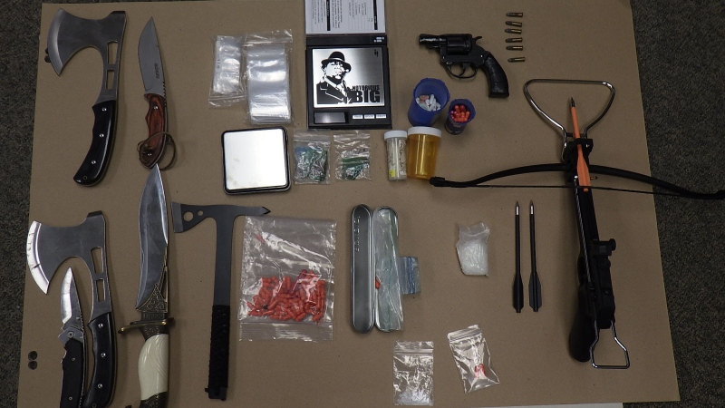 Drugs and weapons seized from a home by Stratford Police are shown in this photograph. (Stratford Police)