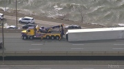 Extreme wind blows over transport truck