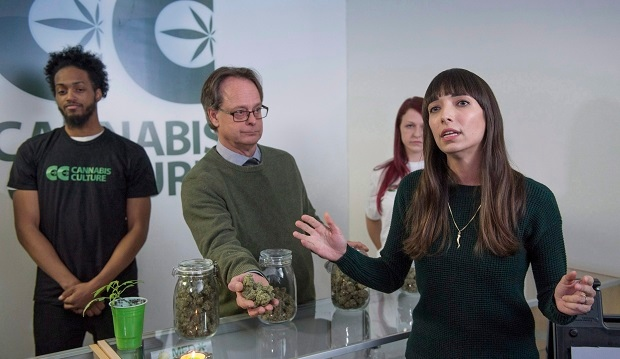 Jodie Emery, who owns the Cannabis Culture brand with her activist husband Marc Emery, left, talks to reporters at the opening of one of their stores Thursday, December 15, 2016, in Montreal. Several other pot dispensaries are set to open in Montreal this week that will be selling marijuana to recreational users, despite federal rules that forbid such shops. (THE CANADIAN PRESS/Paul Chiasson)