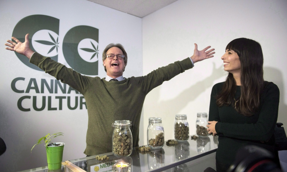 In this Thursday, December 15, 2016 file photo, Marc Emery, who owns the Cannabis Culture brand with his wife Jodie, right, gestures at the opening of one of their pot stores in Montreal. (Paul Chiasson / THE CANADIAN PRESS)