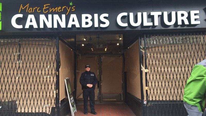 A Vancouver police officer is stationed outside the Cannabis Culture location on Hastings Street during a warrant execution on March 9, 2017. (CTV)