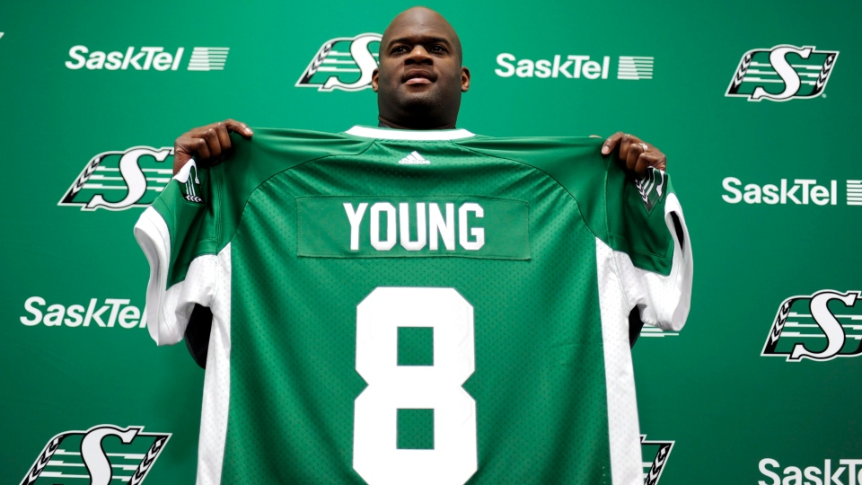 Vince Young, a quarterback formerly with the NFL's Philadelphia Eagles and Tennessee Titans, holds up a jersey after signing with the CFL's Saskatchewan Roughriders at Mosaic Stadium in Regina Thursday, March 9, 2017. THE CANADIAN PRESS/Mark Taylor