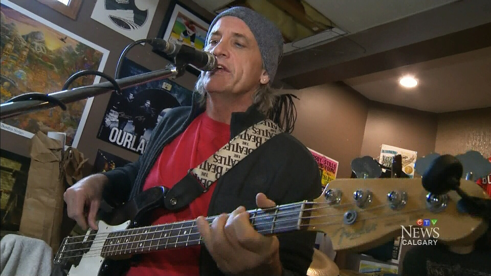 Dail Croome of Daring Greatly rocks out in the basement of his Calgary home. (CTV Calgary)