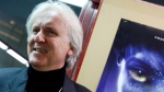 "Film director James Cameron poses for photos prior to the opening of the movie ""Avatar"" in Davos, Switzerland on Jan. 28, 2010. (Virginia Mayo/AP)"