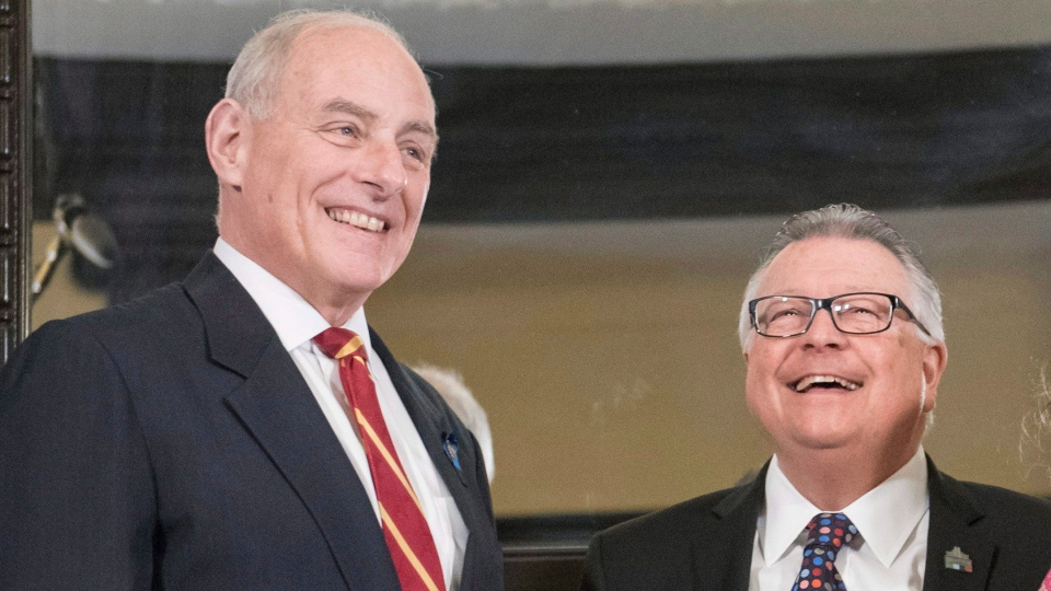 U.S. Secretary of Homeland Security John Kelly, left, stands with Minister of Public Safety Ralph Goodale during a photo op on Parliament Hill on Friday, March 10, 2017 in Ottawa. (Justin Tang/The Canadian Press)