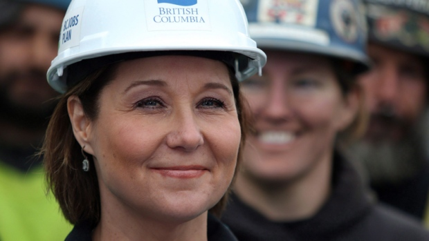 Premier Christy Clark looks on at a news conference at a construction site along Johnston Street in Victoria, B.C., on Wednesday, March 1, 2017. THE CANADIAN PRESS/Chad Hipolito